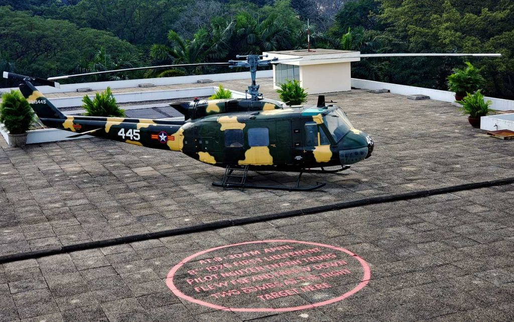 On the helipad next to the rooftop hut the Huey sits at the ready (well it used to be at the ready back in '75).