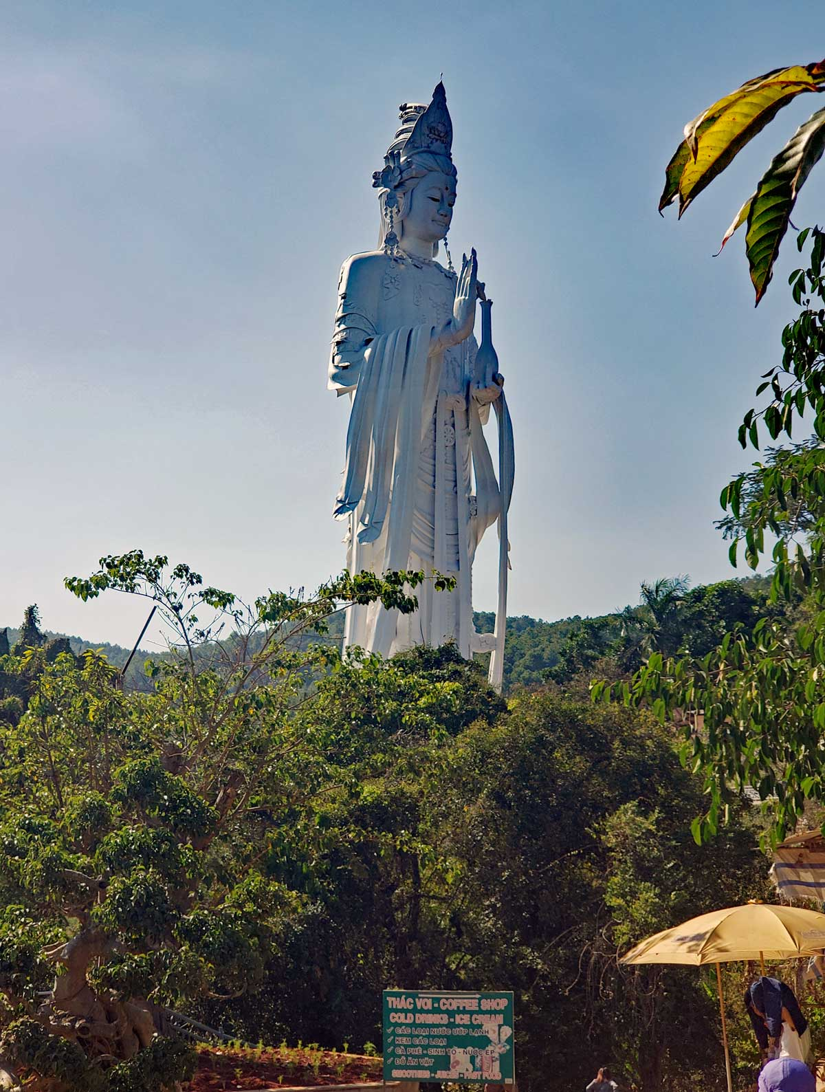 The big female Buddha sits above the falls at the Pagoda.